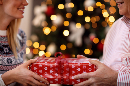Photo for father and daughter exchanging Christmas gifts close up - Royalty Free Image