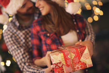 Foto de Couple with Christmas gift, concept - Imagen libre de derechos