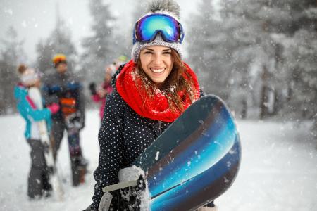 Foto de portrait of cool young girl snowboarder - Imagen libre de derechos