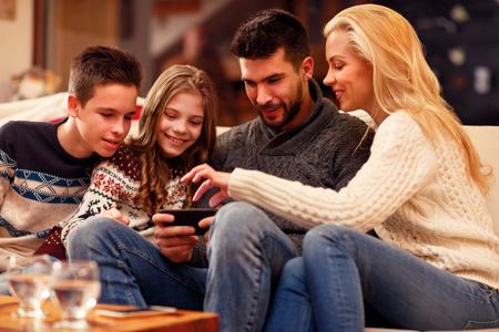 Family having fun on digital tablet for Christmas time