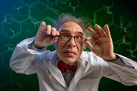 Foto de  funny chemistry professor adjusts his glasses and look in camera  - Imagen libre de derechos