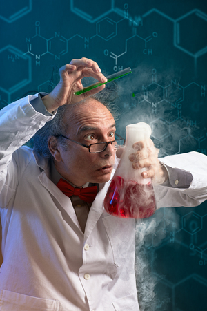 Foto de  Crazy chemist scientist focused on danger experiment over abstract background  - Imagen libre de derechos