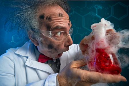 Foto de crazy scientist hysteric looking at exploded experiment - Imagen libre de derechos