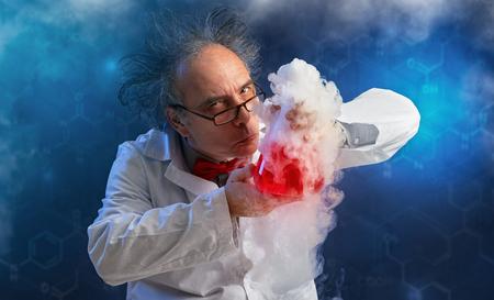 Foto de  Wacky chemist with experiment sense of smell evaluates chemicals - Imagen libre de derechos