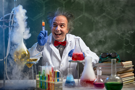 Foto de happy crazy chemistry with injection sprays in the air - Imagen libre de derechos