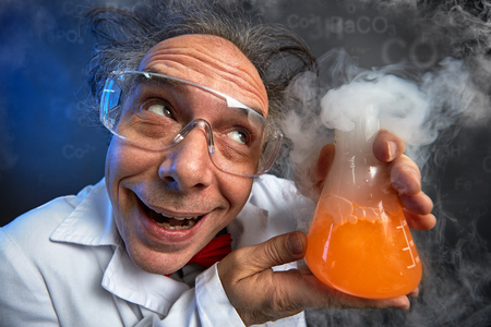Foto de  Happily crazy chemist with his experiment in test tube - Imagen libre de derechos
