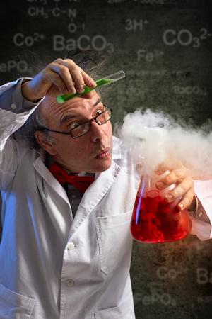 Foto de  Scientist added drop of important chemical in experiment, danger experiment - Imagen libre de derechos