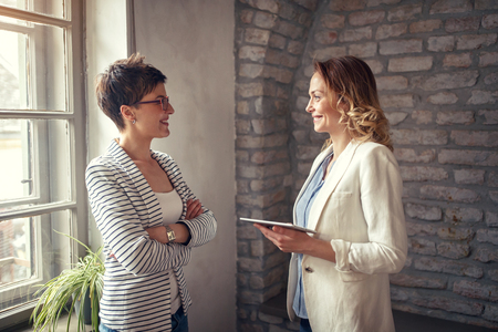 Photo for business women exchanging ideas at the meeting - Royalty Free Image