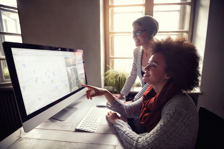 Foto de designer colleagues discussing graphs in office - Imagen libre de derechos