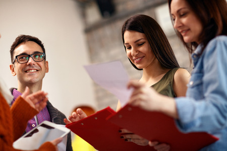 Photo for smiling architects with leader working together on project - Royalty Free Image