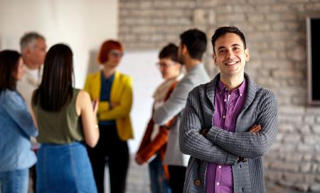 Foto de Portrait of businessman with colleagues in background - Imagen libre de derechos