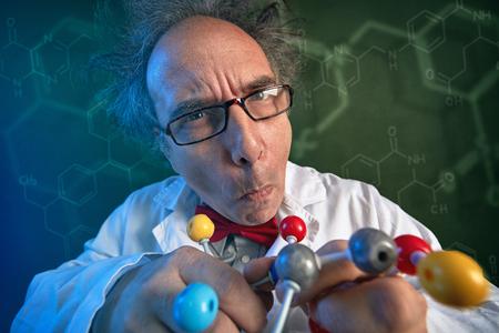 Foto de Funny scientist with chloroform molecular structure model - Imagen libre de derechos