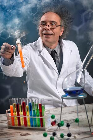 Foto de scientist theme: funny crazy chemist  working in a laboratory - Imagen libre de derechos