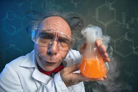 Foto de Very funny scientist satisfied holding testing tube - Imagen libre de derechos