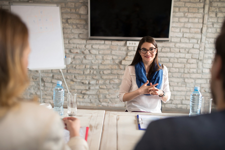 Photo for Nervous woman talking with commission on interview for job - Royalty Free Image