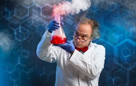 Foto de Chemist carefully oversees his experiment over abstract - Imagen libre de derechos