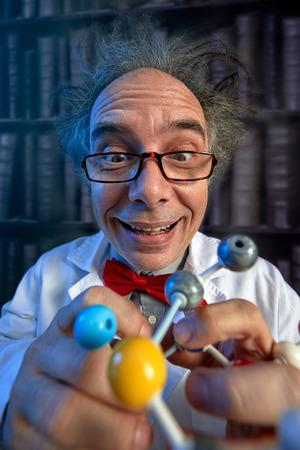 Foto de Happy scientist with plastic molecular structure model - Imagen libre de derechos