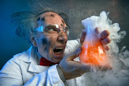 Foto de Angry scientist with his failed experiment, yelling on test tube - Imagen libre de derechos