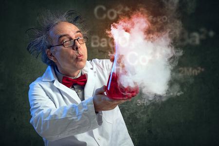 Foto de Chemist blowing in his experiment to put off explosion - Imagen libre de derechos