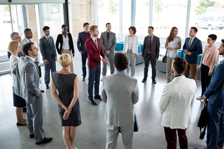 Photo for young leader standing in circle of his successful business team - Royalty Free Image
