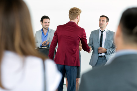 Photo for business partners handshaking with leader in the sign of successful dealing - Royalty Free Image