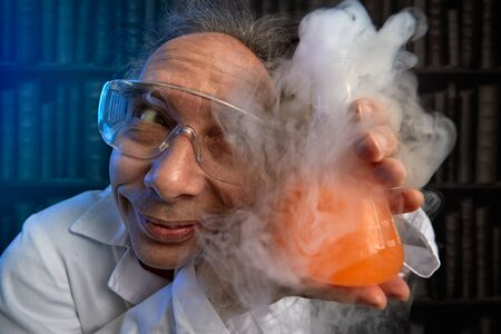 Foto de Crazy scientist to worship refers to his experiment, funny chemist - Imagen libre de derechos
