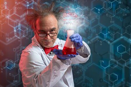 Foto de Crazy chemistry showing his succeed product of experiment - Imagen libre de derechos