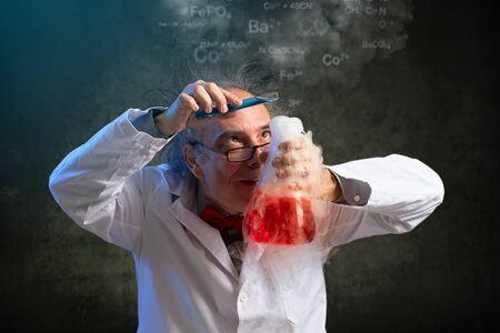 Foto de Very scientist focused on final touch in his experiment - Imagen libre de derechos