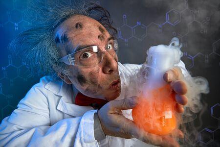 Foto de Funny scientist dirty face after explosion in lab - Imagen libre de derechos