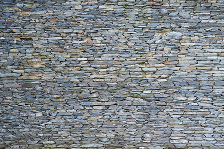 Foto de The surface of the stone wall background - Imagen libre de derechos