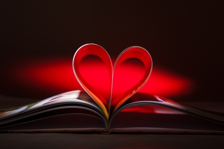 Photo for Pages of book curved into a heart shape - Royalty Free Image