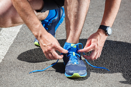 Photo pour Runner trying running shoes getting ready for run. - image libre de droit
