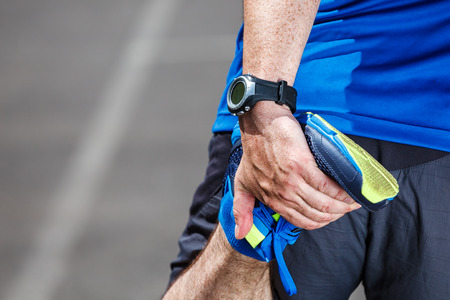 Photo pour Male runner stretching before workout. - image libre de droit