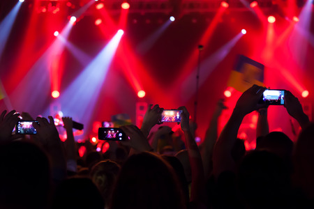 Photo pour People at concert shooting video or photo. - image libre de droit