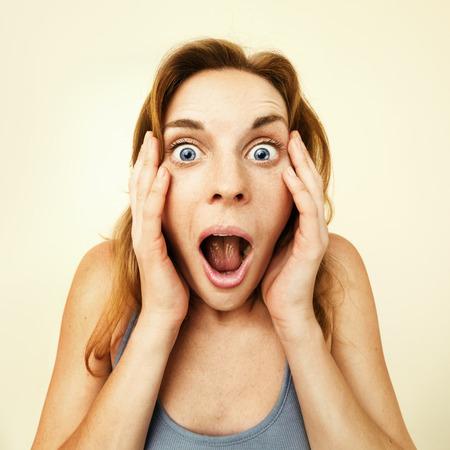 Photo pour Beautiful young woman surprised - wide angle lens effect. - image libre de droit