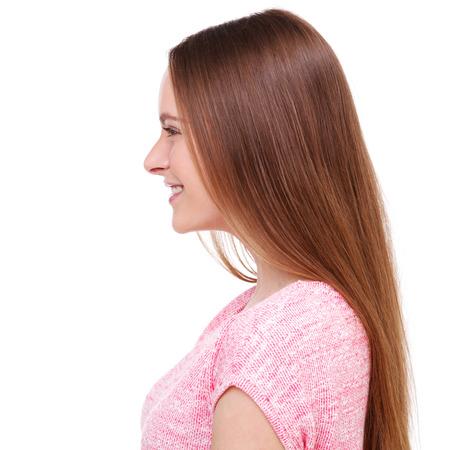 Foto de Profile of beautiful young woman isolated on white background. - Imagen libre de derechos
