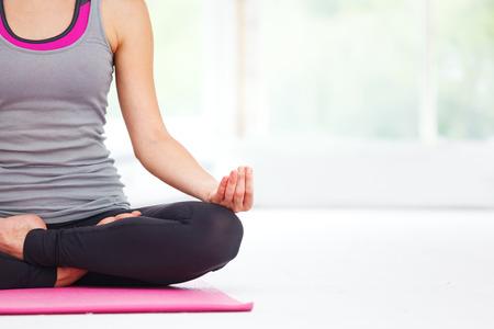 Foto de Young beautiful woman doing yoga indoors. - Imagen libre de derechos