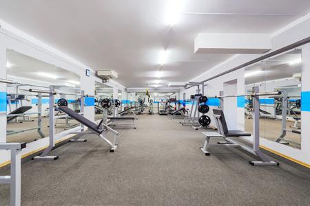 Foto de Modern gym interior with sports equipment. - Imagen libre de derechos