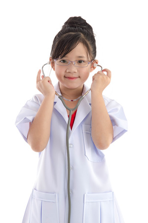 Beautiful asian girl in a doctors uniform on white background isolated