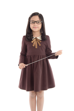 Photo for Portrait of beautiful asian girl wearing uniform and holding wand on white background isolated - Royalty Free Image