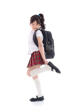 Foto de Portrait of asian child in school uniform on white background isolated - Imagen libre de derechos
