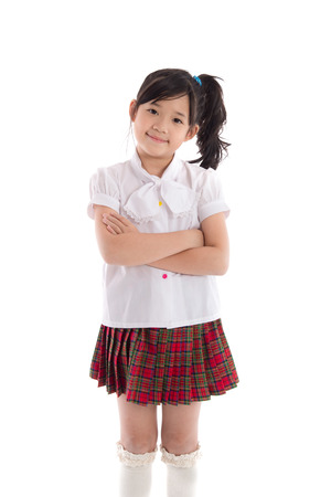 Photo pour Portrait of asian child in school uniform on white background isolated - image libre de droit