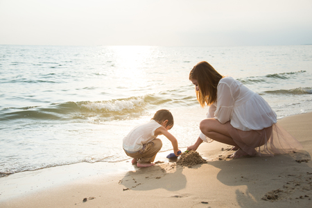 Photo for mother and son playing on the beach,vintage filter - Royalty Free Image