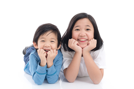 Cute Asian children lying on white background isolated