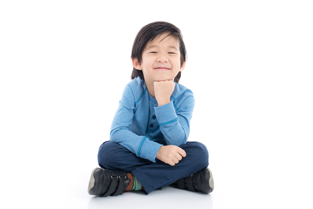 Photo for Happy asian boy sitting on white background isolated - Royalty Free Image