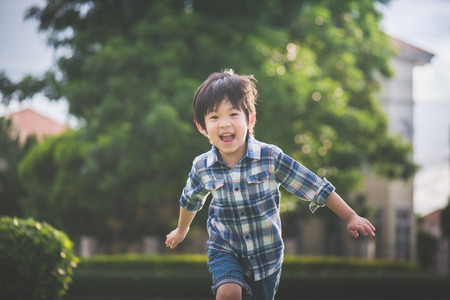Photo pour Asian child playing in the park - image libre de droit