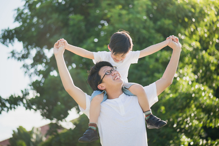 Photo for Asian father and son playing in the park - Royalty Free Image