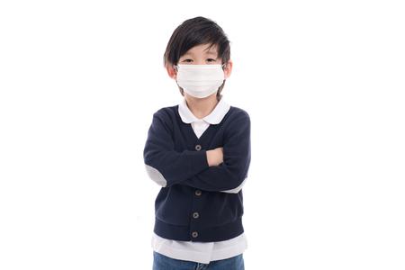 Foto de Asian child with protection mask on white background isolated - Imagen libre de derechos
