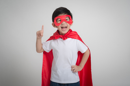 Photo pour Portrait of Asian child in in Superhero's costume on gray background - image libre de droit