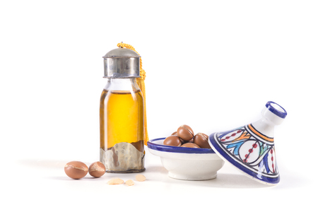 Photo for Argan oil and fruits, used  for skin care and hair on a white background. - Royalty Free Image